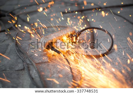 burning electrical outlet shorting, danger - stock photo