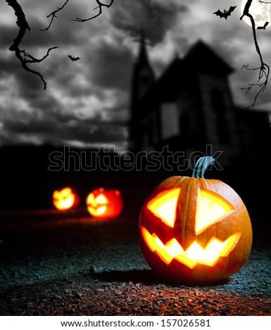 Burning evil halloween pumpkin with dark background - stock photo