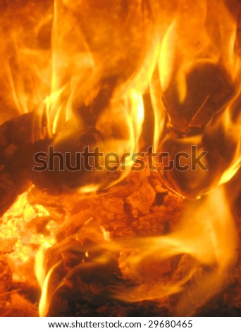 Burning fire and charcoal, may be used as background - stock photo