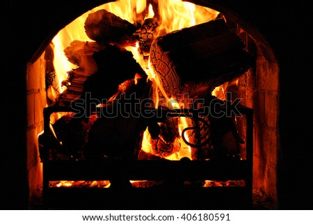 burning fire in the fireplace, firewood, flames - stock photo