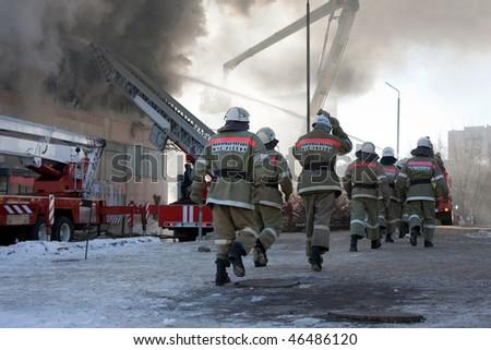 Burning fire, smoke, firefighters' emergency service - stock photo