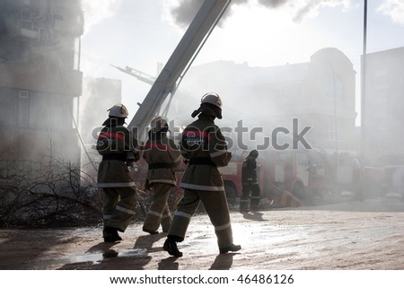 Burning fire, smoke, firefighters' emergency service - stock photo