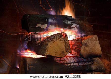 Burning firewood at campfire - stock photo