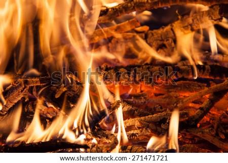 Burning firewood in the fireplace closeup - stock photo
