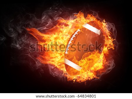 Burning football ball enveloped in fire flame isolated on black background.  - stock photo