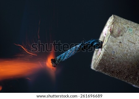 Burning fuse of a firecracker.  - stock photo