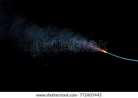 Burning fuse with sparks isolated on black background