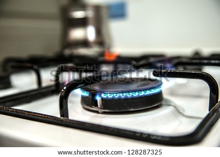 Burning gas oven in kitchen - stock photo