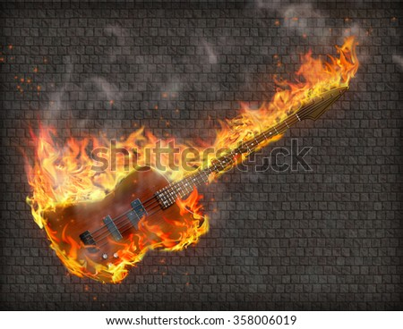 Burning Guitar with smoke against grungy stone wall - stock photo