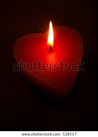 burning heart candle - stock photo