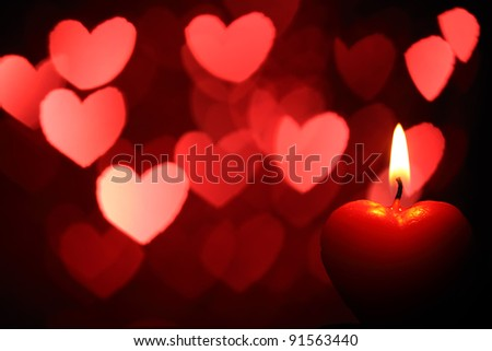 Burning heart-shape candles for Valentine's Day - stock photo