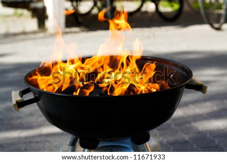 burning hot barbeque in the backyard - stock photo