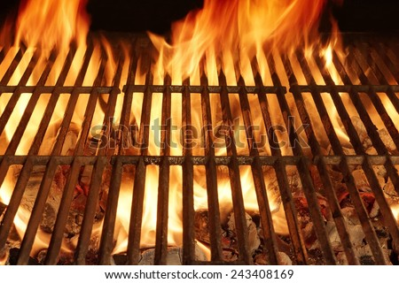 Burning Hot Fire in a  Barbecue with an Empty Grill - stock photo