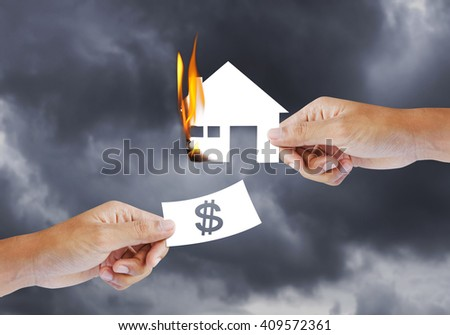Burning house, Fire insurance - stock photo