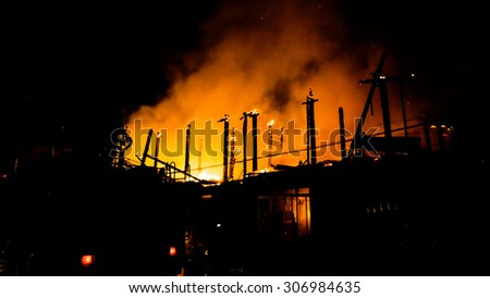 Burning house,House on fire. - stock photo