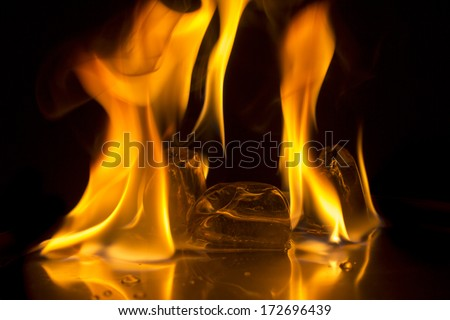 Burning ice cube on  background