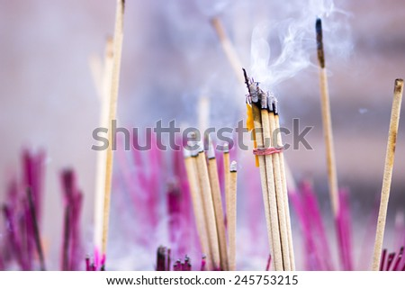 Burning incense and candles in thailand temple - stock photo