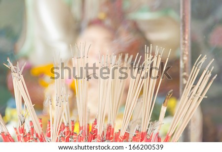 Burning Incense in Ancient Chinese Temple  - stock photo