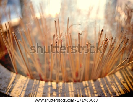 Burning incense in Chinese temple - stock photo