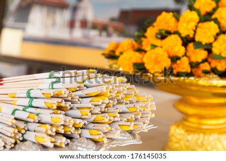 Burning incense sticks for pray and flower background-3 - stock photo