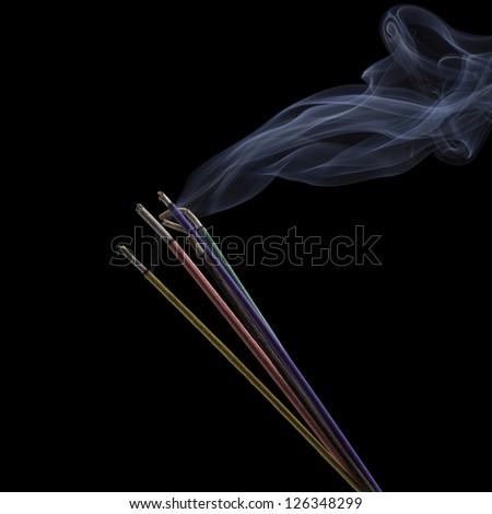 Burning Incense Sticks isolated on black - stock photo