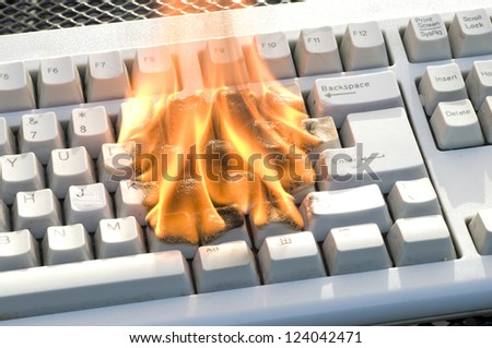 Burning Keyboard of a PC - stock photo