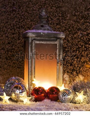 Burning lantern burning on a balcony at christmas time - stock photo