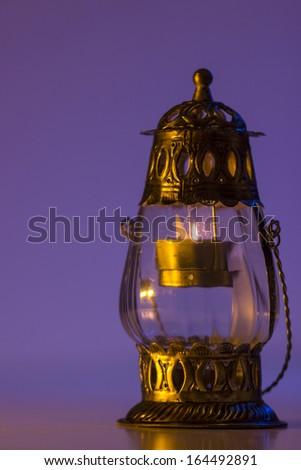 Burning lantern in the dark - stock photo