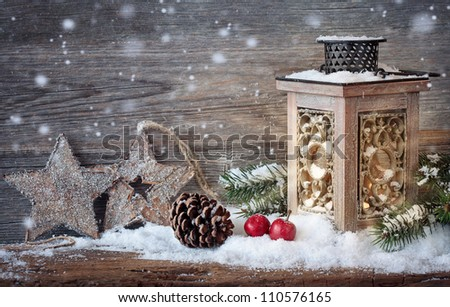 Burning lantern in the snow - stock photo
