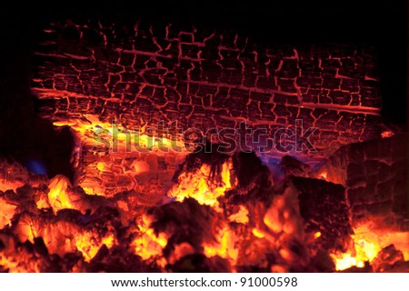 Burning logs of firewood before falling into smithereens. - stock photo