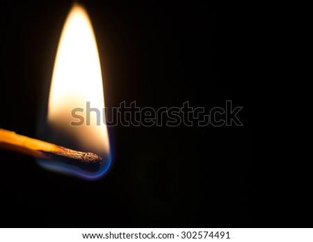 Burning Match Isolated On Black - stock photo