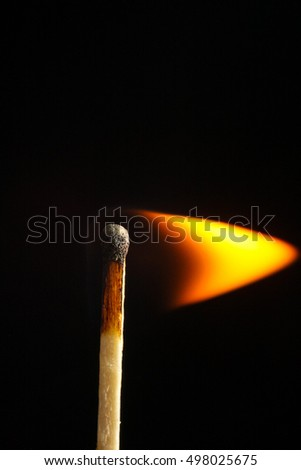 burning match on black background flame wood stick macro