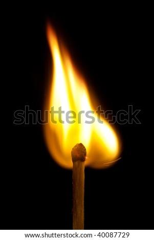 Burning match on green background - stock photo