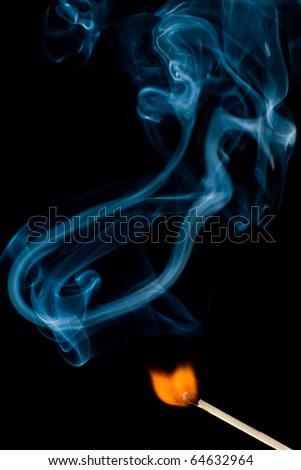 burning match on the black background - stock photo