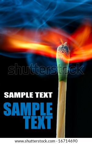 Burning match over black background and space for your own text - stock photo