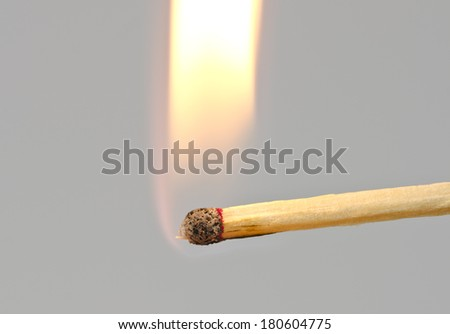 burning match with a flame - stock photo