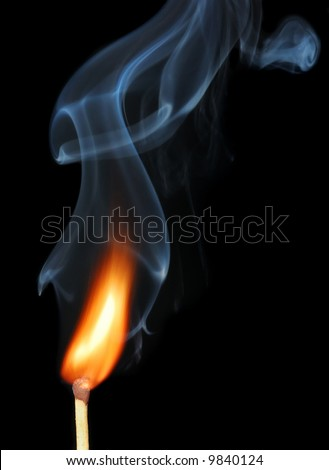 burning match with smoke on black - stock photo