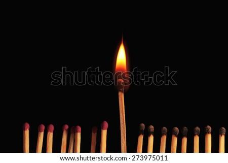 Burning matches on dark background - stock photo