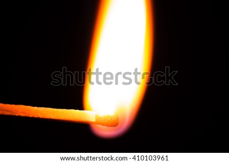 burning matchstick on black background. Fire  close up - stock photo