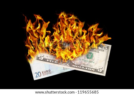 Burning money, dollar and euro bill on fire, isolated on black