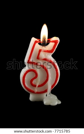 Burning number five candle with dripping wax.