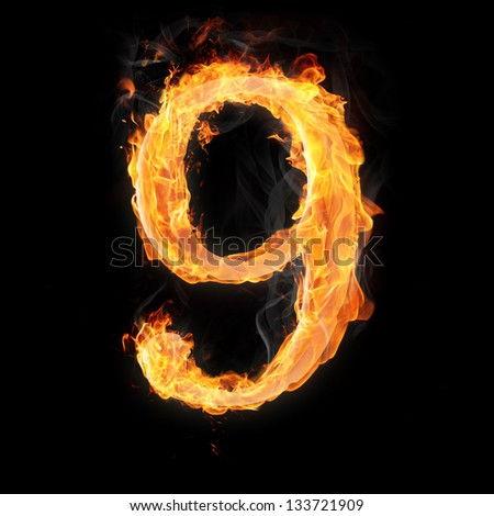 Burning numbers on black background - number nine - stock photo