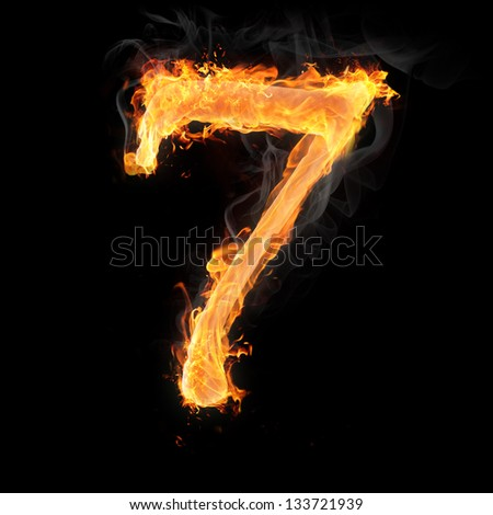 Burning numbers on black background - number seven - stock photo