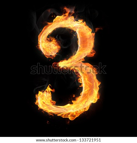 Burning numbers on black background - number three - stock photo