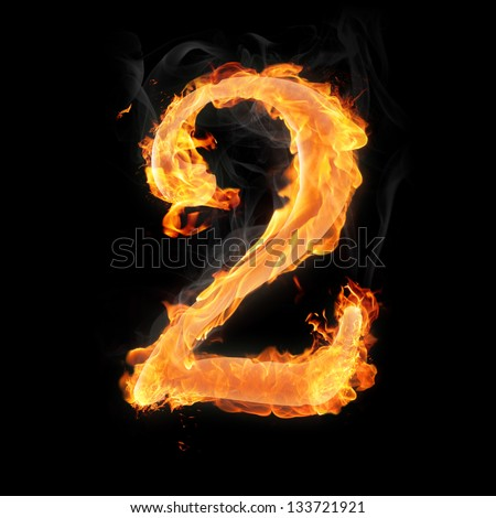 Burning numbers on black background - number two - stock photo