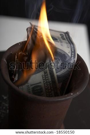 Burning of money on fire - stock photo