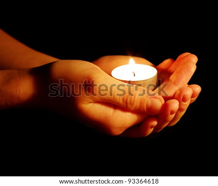 Burning of the candle in a hand