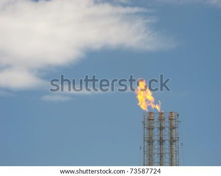 Burning oil gas flare - stock photo