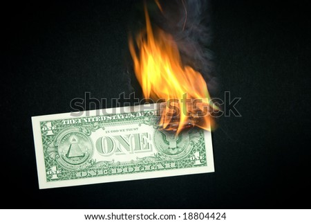 Burning one dollar with flames and smoke.