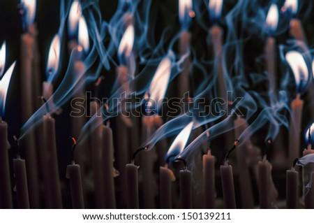 burning orange candles close up - stock photo